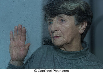 Loneliness in old age - Old women feels lonely, unhappy and...