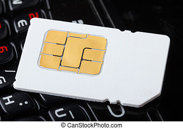 Sim card on cell phone keyboard