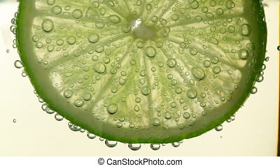 lime with bubbles  - lime in water with bubbles