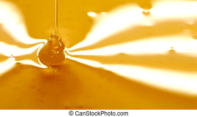 pouring honey - close up of pouring honey on honey
