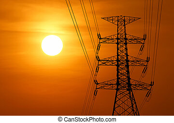 silhouette of high voltage electric tower with beautiful...