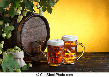 barrel with two beer glasses - Vintage beer barrel with two...