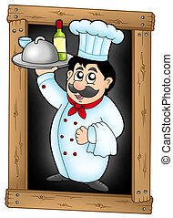 Chef holding meal on blackboard