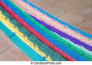 Colorful Mexican hammock over tile floor