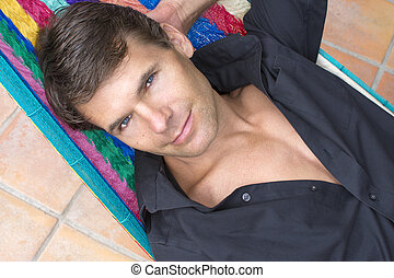Sexy handsome man relaxing - Closeup handsome Caucasian man...