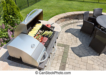 Grilling food on an outdoor gas barbecue - Grilling healthy...