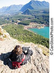 Woman enjoying rewarding view of Rattlesnake Ledge Trail -...