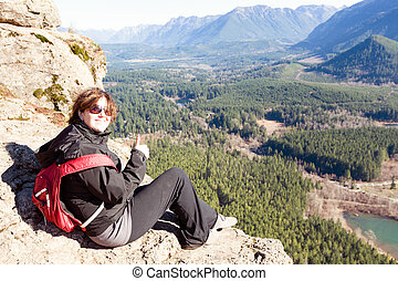Smiling happy woman on the Rattlesnake Ledge Trail - Smiling...