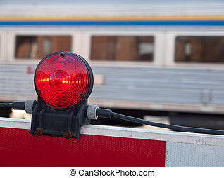 Train Crossing - Closeup of train crossing barrier with red...
