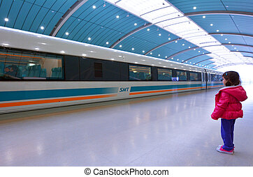 Little girl travel on Shanghai Maglev Train - SHANGHAI - MAR...