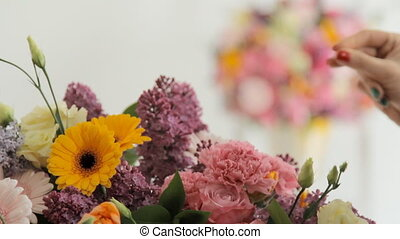 Florists make a huge bouquet from a variety of colorful...