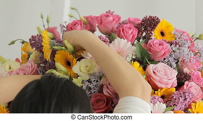 Florists make a fashion bouquet from a huge variety of colorful flowers