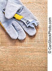 adjustable spanner obverse on side of the protective glove...