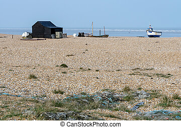 Old shack and boats on Dungeness beach