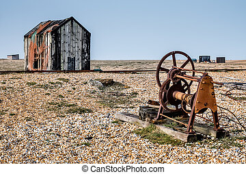 Old shack and rusty machinery on Dungeness beach
