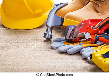 hammer spanner boots helmet gloves tapeline