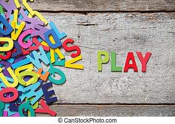 "PLAY - The colorful words ""PLAY"" made with wooden letters..."