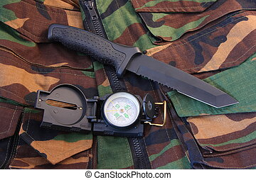 Tubular compass and knife on camo - Tubular compass, and...