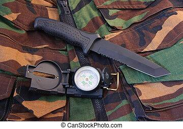 Tubular compass and knife on camo - Tubular compass, and...