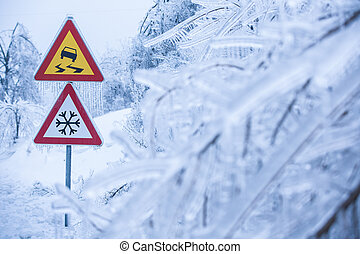 Dangerous and icy road sign - Dangerous and icy road with...