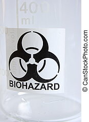 Biohazard sign on empty glass beaker