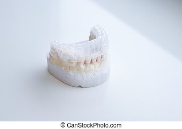 Invisalign, invisible plastic teeth aligner on a dental...