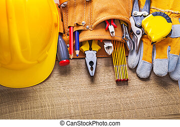 set of construction tools in toolbelt
