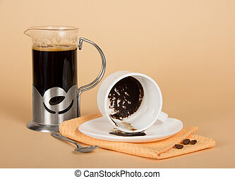 Coffee pot and overturned cup - Coffee pot, the overturned...