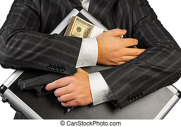 Case with Money and gun - Human hands and case with Money...