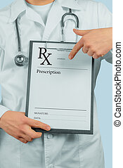 Doctor pointing on clipboard with prescription paper
