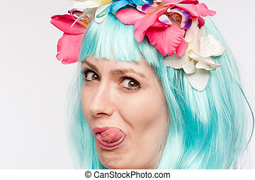 Crazy Girl Wig Tongue Out - Girl with headdress and blue wig...