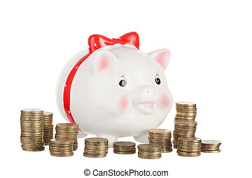 Amusing pig moneybox and columns from gold coins on a white...