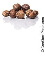 Nutmeg over white background
