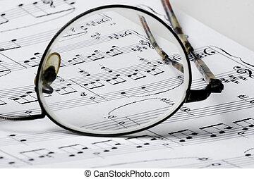 glasses on sheet music
