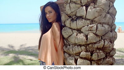 Pretty Woman Leaning Against Beach Palm Tree Trunk - Close...