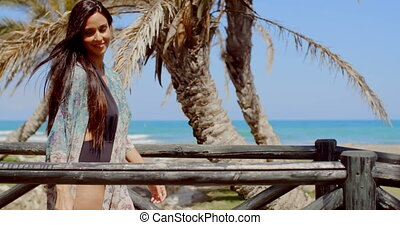 Pretty Woman Standing at the Railing at the Beach - Smiling...
