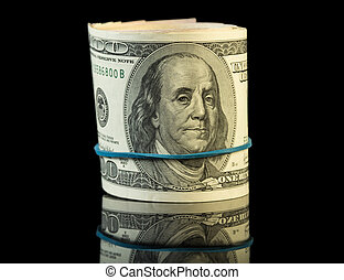 Dollar bills rolled up - Hundred dollar bills rolled up on...
