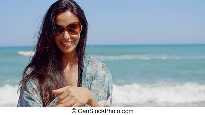 Smiling Pretty Girl at the Beach Wears Sunglasses