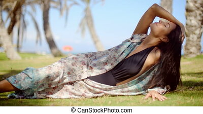 Pretty Woman in Summer Dress Resting on Grassy - Close up...