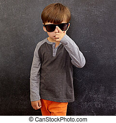 Cool little boy wearing sunglasses - Portrait of little boy...