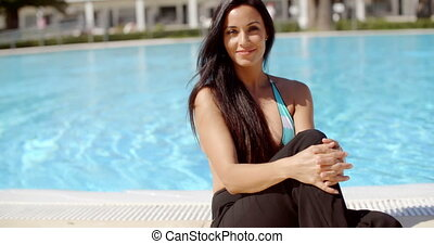 Happy Sexy Young Woman Relaxing at the Poolside - Happy Sexy...
