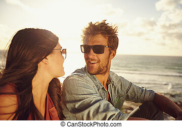 Romantic young couple at the beach - Close-up portrait of...