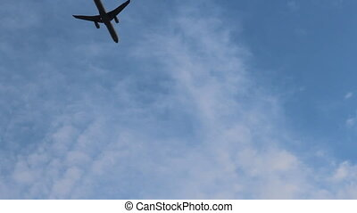 Silhouette of an airplane taking off into a surreal colorful...