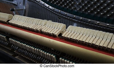 Inside the Piano. Hammers striking strings.