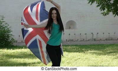 woman dancing with union jack outdoors slowmo footage