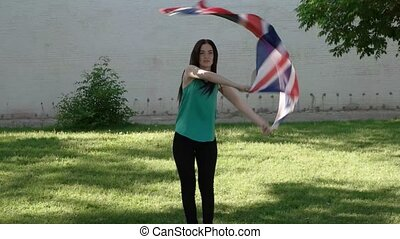 Women and union jack flag having fun outdoors slowmo footage