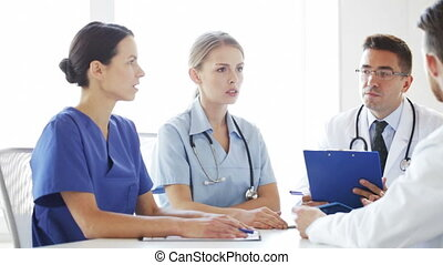 group of doctors meeting and talking at hospital - hospital,...