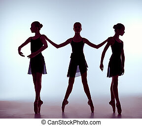 Composition from silhouettes of three young ballet dancers -...