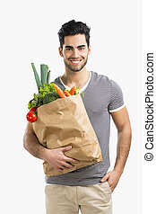 Man carrying a bag full of vegetables