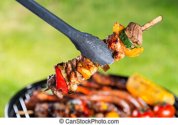 Delicious skewers on grill - Delicious vegetable and meat...
